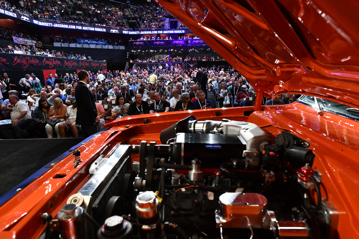 Inside the hood of a classic car at the auction